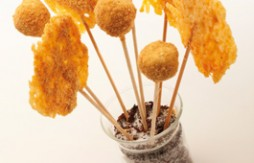 Cured Mahon Cheese Lollipops with Quely Picada biscuit crumbs, and Duck Liver Paté and Goat's Cheese